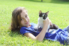Young girl playing with her cat Royalty Free Stock Photos