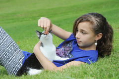 Young girl playing with her cat Royalty Free Stock Image