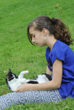 Young girl playing with her cat Stock Photography