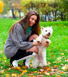 Young girl playing with her dog Stock Images