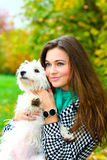 Young girl playing with her dog Royalty Free Stock Photography