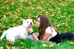Young girl playing with her dog Stock Photo