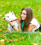 Young girl playing with her dog Royalty Free Stock Photo