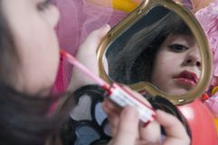 Young girl playing with her make up kit Stock Photo