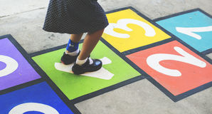 Young girl playing hopscotch Royalty Free Stock Photography