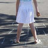 Young girl playing hopscotch, close-up Royalty Free Stock Photography