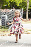 Young girl playing hopscotch Stock Images