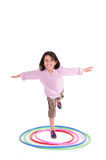 Young girl playing with hula hoop isolated over Royalty Free Stock Image