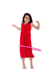 Young girl playing with hula hoop isolated over Stock Photos