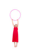 Young girl playing with hula hoop isolated over Royalty Free Stock Photography