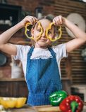 Young girl is playing in the kitchen royalty free stock photo
