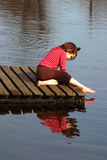 Young girl playing beside lake. Young girl was playing water beside a lake in Kensington Garden, London Stock Image