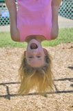 Young girl playing on monkey bars at the park Royalty Free Stock Photo