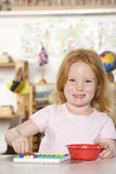 Young Girl Playing at Montessori/Pre-School Stock Photos