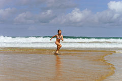 Young girl playing in ocean coast Stock Photo