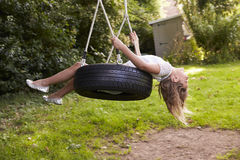 Free Young Girl Playing On Tire Swing In Garden Stock Photography - 85187212