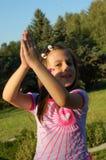 Young girl playing outdoors Stock Photos