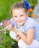Young girl is playing outdoors Royalty Free Stock Images