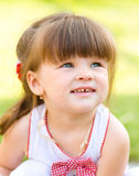 Young girl is playing outdoors. Young cheerful girl is playing outdoors Royalty Free Stock Photos