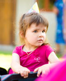 Young girl is playing outdoors Royalty Free Stock Photo