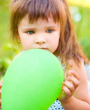 Young girl is playing outdoors Stock Photos