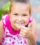 Young girl is playing outdoors Royalty Free Stock Image