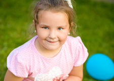 Young girl is playing outdoors Royalty Free Stock Photos