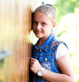 Young girl is playing outdoors. Young cheerful girl is playing outdoors Royalty Free Stock Photo