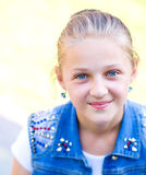 Young girl is playing outdoors. Young cheerful girl is playing outdoors Stock Photography