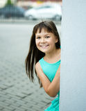 Young girl is playing outdoors. Young cheerful girl is playing outdoors Royalty Free Stock Photography