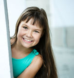 Young girl is playing outdoors Stock Image