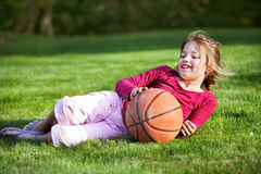 Young girl playing outside Stock Photography