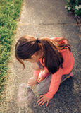 Young girl playing outside. Royalty Free Stock Image