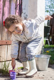 Young girl playing with paints Royalty Free Stock Image
