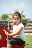 Young girl playing at the park. A young smiling girl playing Royalty Free Stock Images