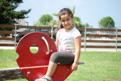 Young girl playing at the park. A young smiling girl playing Royalty Free Stock Photography
