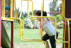 Young girl playing at the park. A young smiling girl playing at the park Royalty Free Stock Image