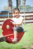 Young girl playing at the park 2. A young smiling girl playing Stock Image