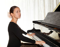 A young girl playing the piano Royalty Free Stock Image