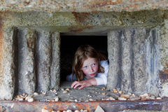 Young Girl Playing in Pill Box stock photography