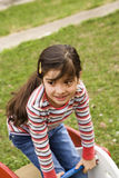 Young Girl Playing on Playground Stock Image