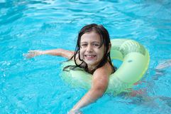 Young girl playing in pool Stock Photo
