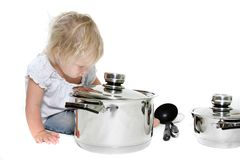 Young girl playing with pots Stock Image