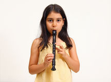 Young Girl Playing Recorder Stock Photo