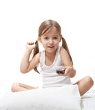 Young girl playing with remote control Royalty Free Stock Images