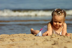 Young girl playing with sand o Stock Photo