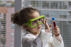 Young girl playing scientist Royalty Free Stock Image