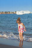 Young girl playing in sea waves Royalty Free Stock Photos