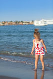 Young girl playing in sea waves Stock Photo