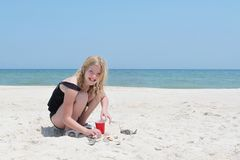 Young Girl Playing With Shells On the Beach Stock Image